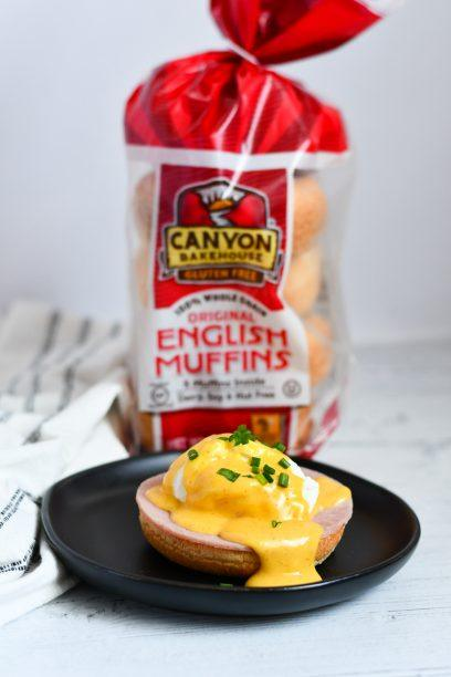 dairy free eggs benedict on a plate with english muffin sin the background