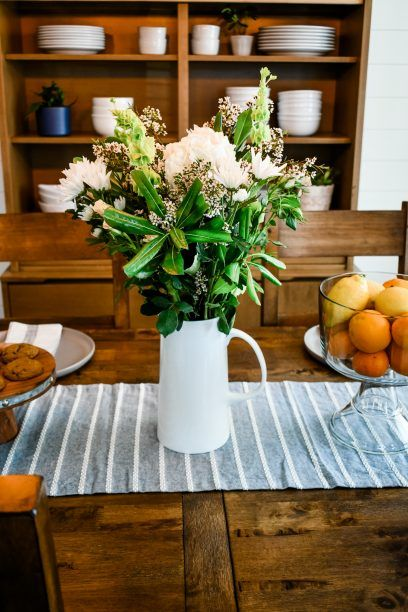 dining room makeover with a table and bouquet of flowers