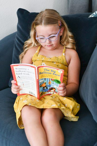 Student sitting and reading from the BookShark curriculum