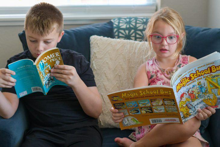 kids reading books from the bookshark science curriculum