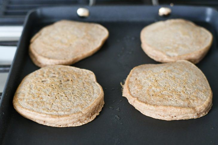 protein pancakes with oats cooking on a skillet