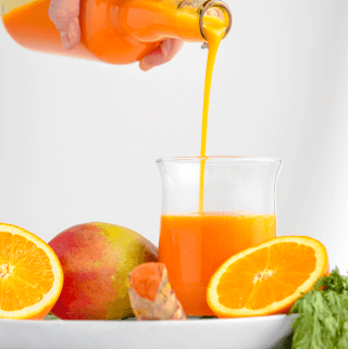orange carrot mango turmeric juice