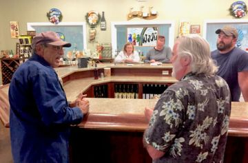 David DelMonaco, the owner, and Jim chat in the tasting room