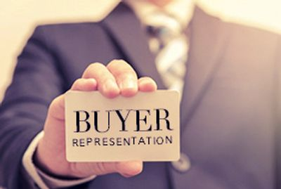 "Image of a man in a suit holding a card that says ""Buyer Representation"""