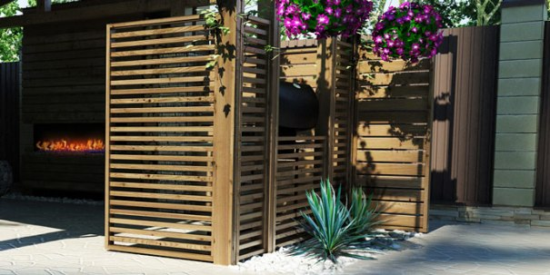 Image of a patio with a wooden screen separator. Purple flowers. Make the most of my backyard