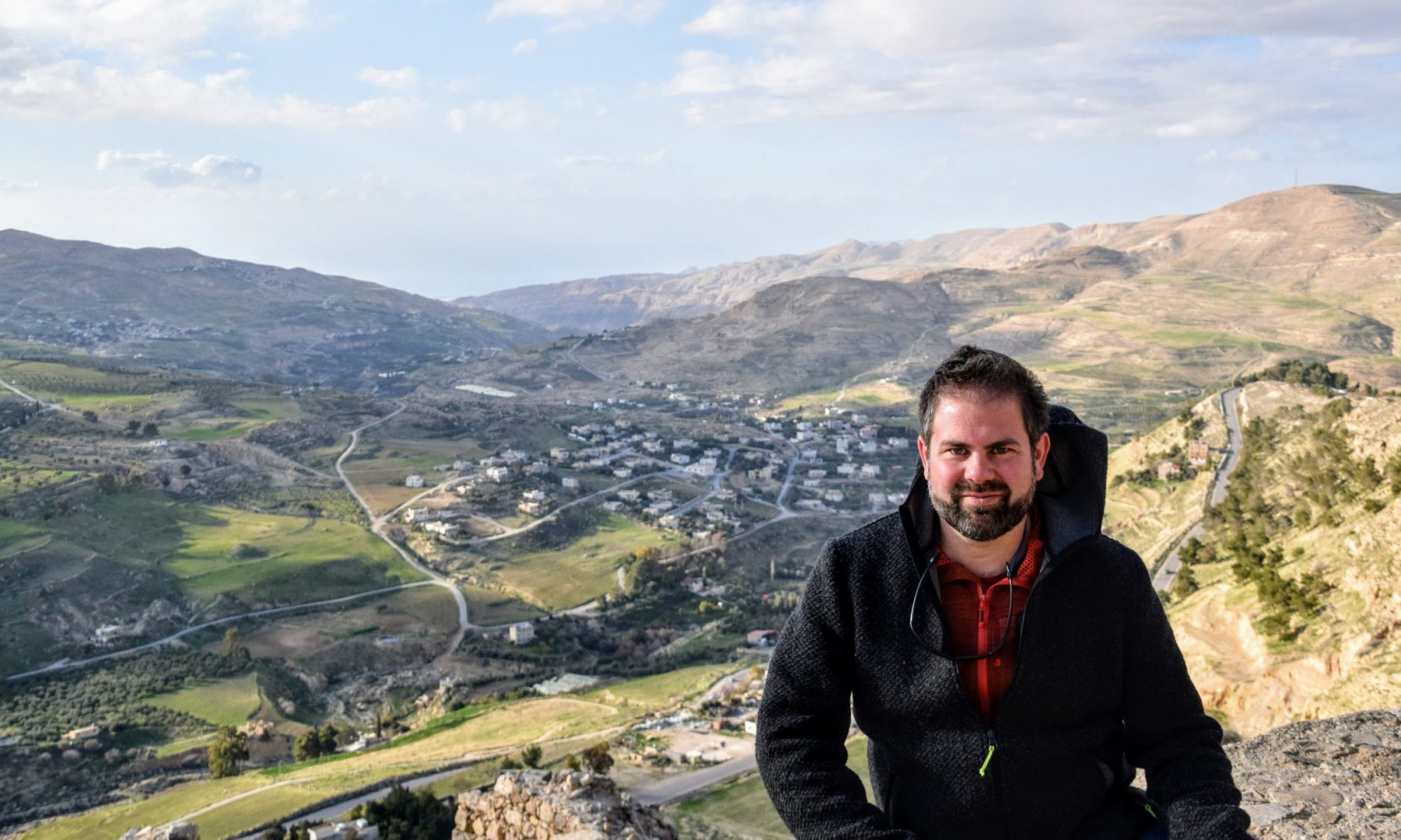 Man sitting on hilltop castle of Karak, Jordan