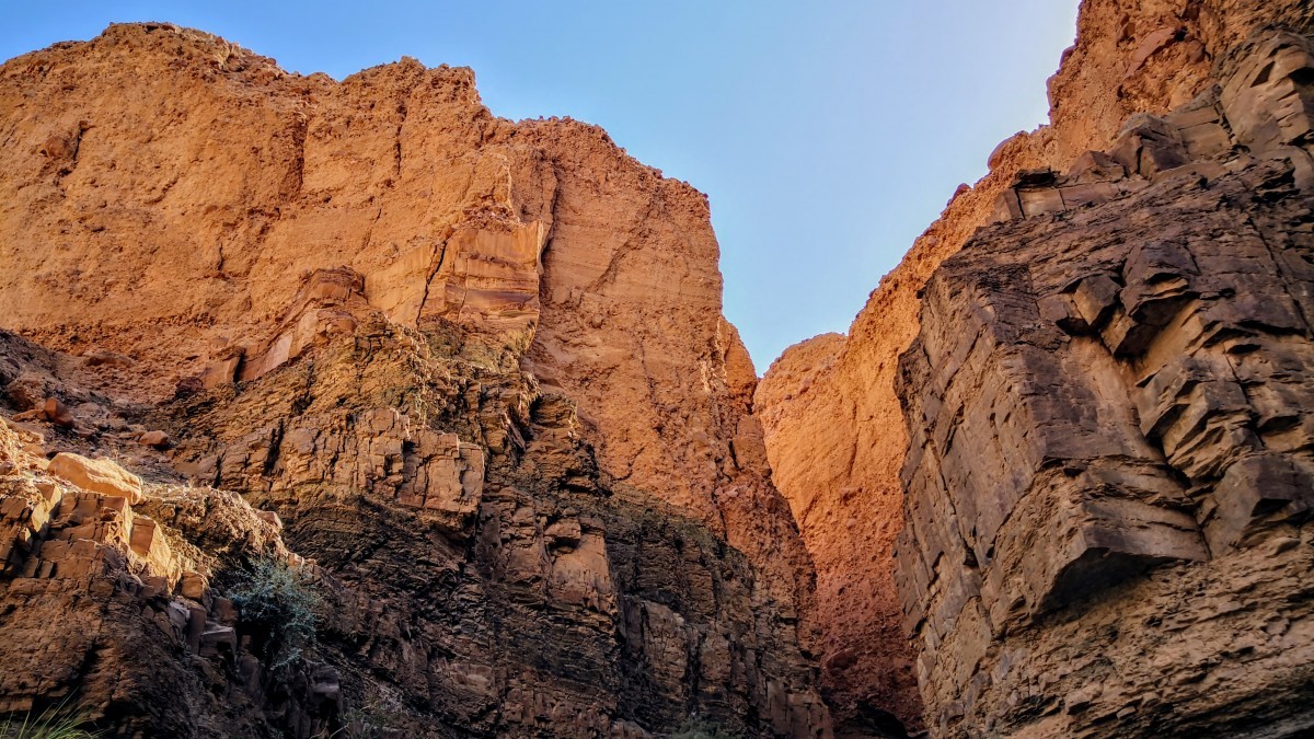 Massive rock formations at Wadi Assal glowing in the sunlight