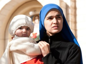 Woman-and-child-outside-parish-church-in-Gaza