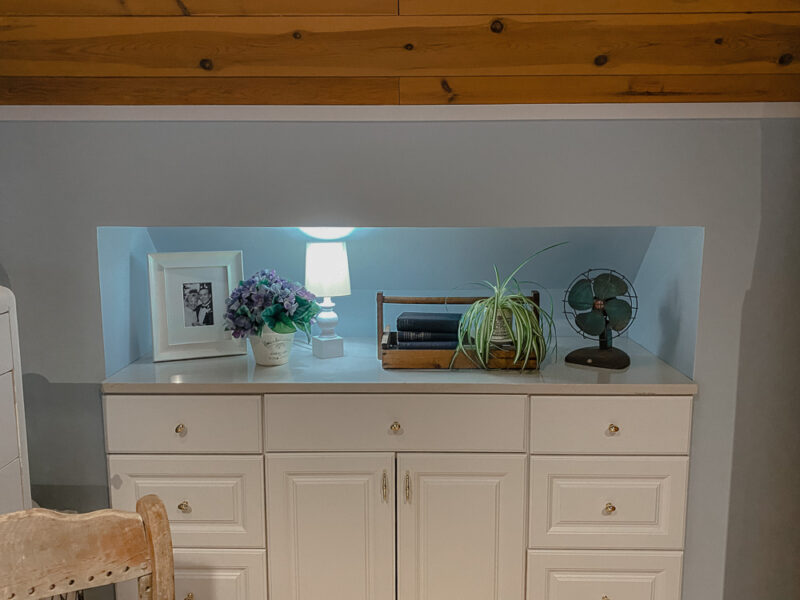 white dresser built into the eaves of a room by handy husband for more storage space