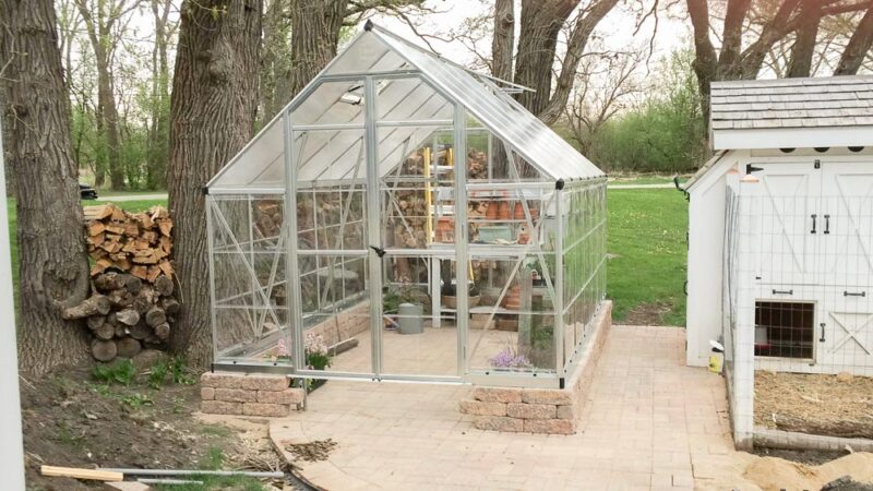 Kit Greenhouse build on brick pavers and landscape blocks to give it a custom look