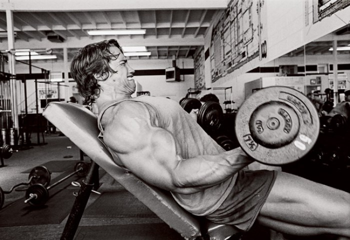Arnold Schwarzenegger training biceps