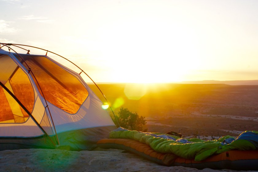 A picture of a tent and sunrise scene.