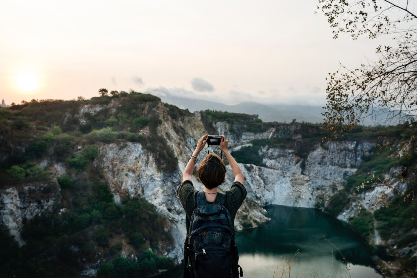 A photo of someone taking a photo of a beautiful canyon.