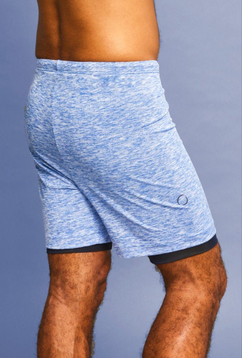 A main wearing a pair of blue 2-dogs yoga shorts.