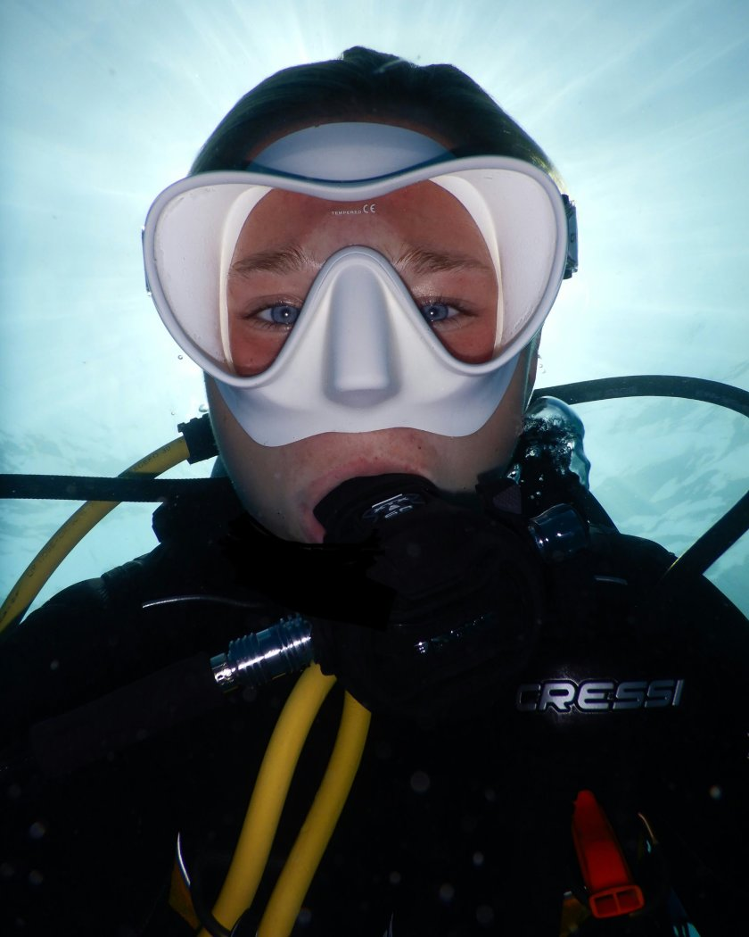 A selfie of Grace scuba diving.