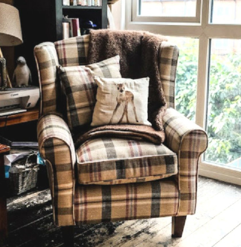 Neyland Star Tartan Fabric Wingback Tub Chair in a cosy corner of a living room