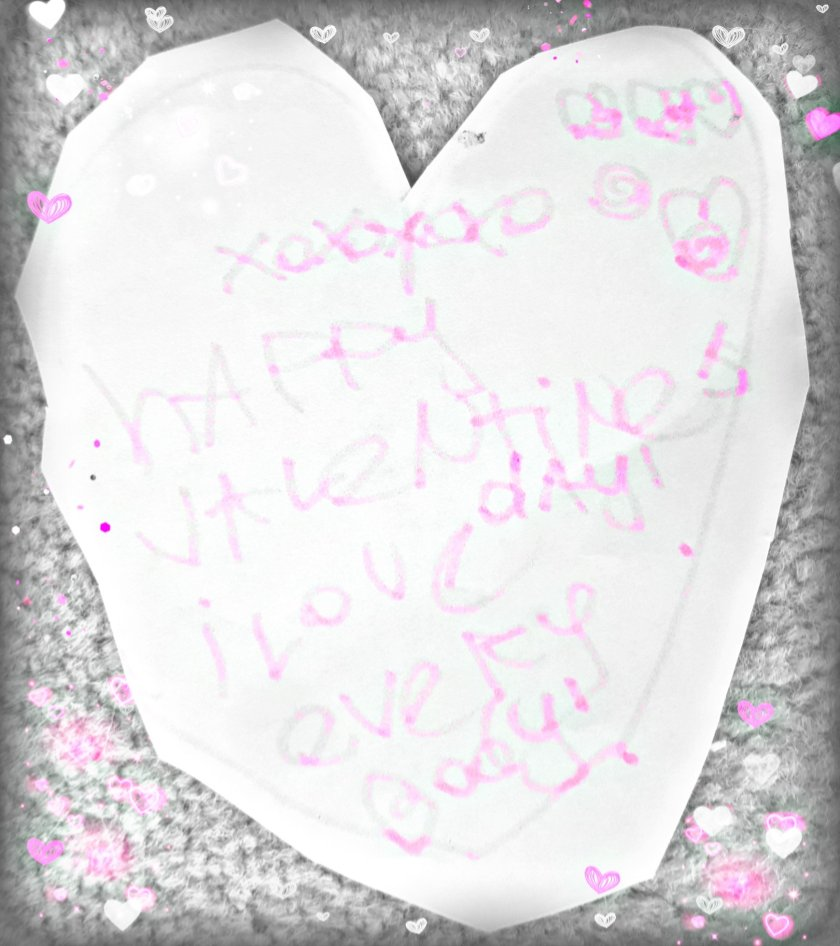 Paper heart cut out with message 'Happy Valentines Day! I love Everbody!' written in pink felt tip with hearts over it.