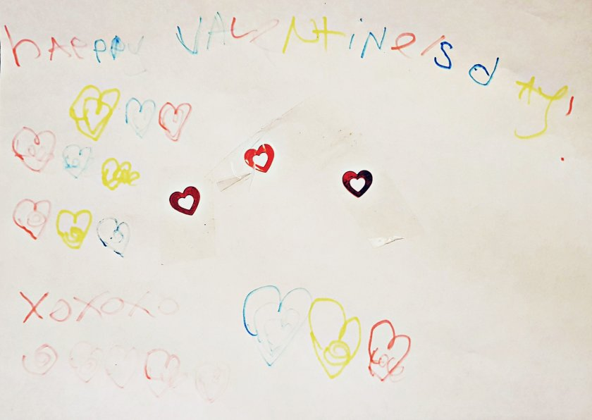 Happy valentines day message with lots of colourful hearts drawn and written by Squiggle.