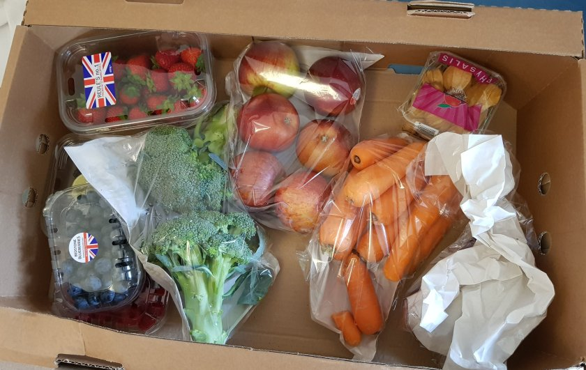 Fruit and veg box full of plastic packaging