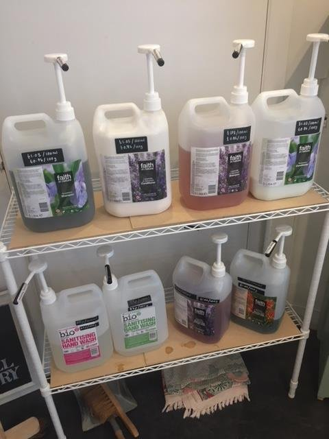 Huge containers of bathroom products at zero waste shop
