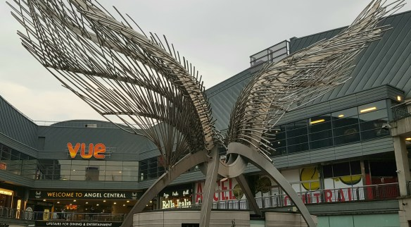 Outside the shopping centre. Angel sculpture. Bella Italia can be seen in the background.
