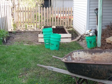 We supplemented the compost with eight buckets of dirt from Kyle's bass player and his wife and a bucket of horse manure that my aunt gave me last year.