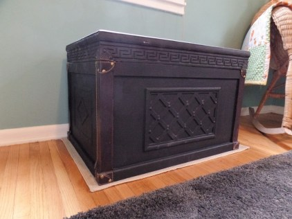 Toy box from Goodwill then refurbished with black paint and support hinges.