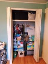 Closet organizer and shelf from Target maximize the closet space.