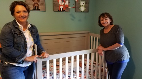 The grandmas pose with TR in his crib for the first time.