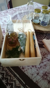 Natures Gift Box for a special person includes Dandelion Jelly, Rosemary & Flower Wine vinegar, Rosemary Branches and Loose Tea, Pure Beeswax Candles & Black Charcoal in wooden box.