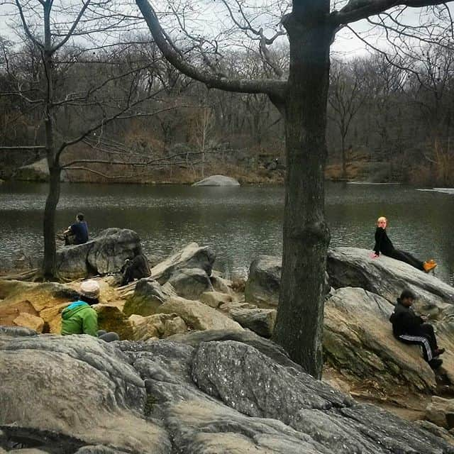 People resting on rocks in Central Park, NYC