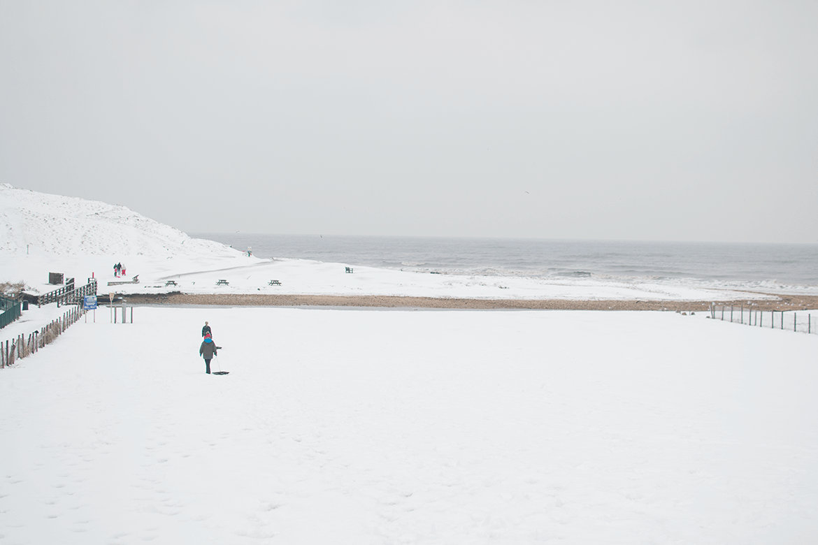 snow on a beach in dorset