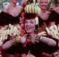 Fresh fruit piled high on top of a hat was Carmen Miranda's signature look.
