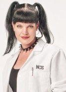 A lab coat, pigtails and fake tattoo turn you into this NCIS babe.