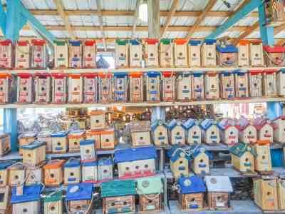 array of handmade birdhouses for sale