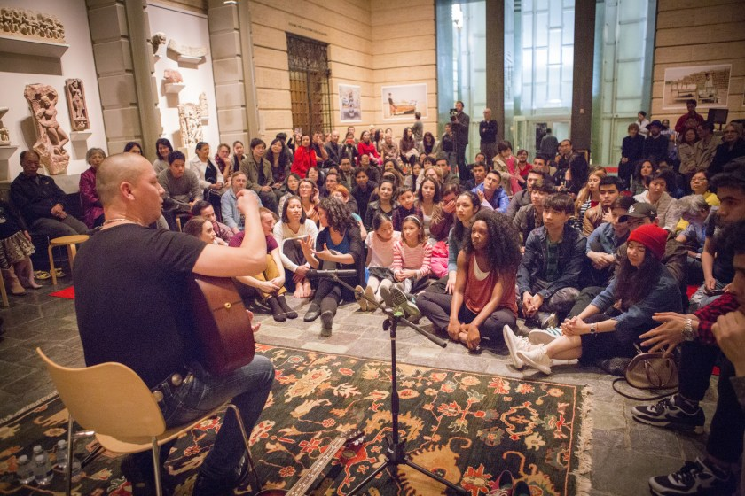 Perhat Khaliq speaks to the audience at SAAM before performing songs from his time on The Voice of China. | Photo by Lisa Ross
