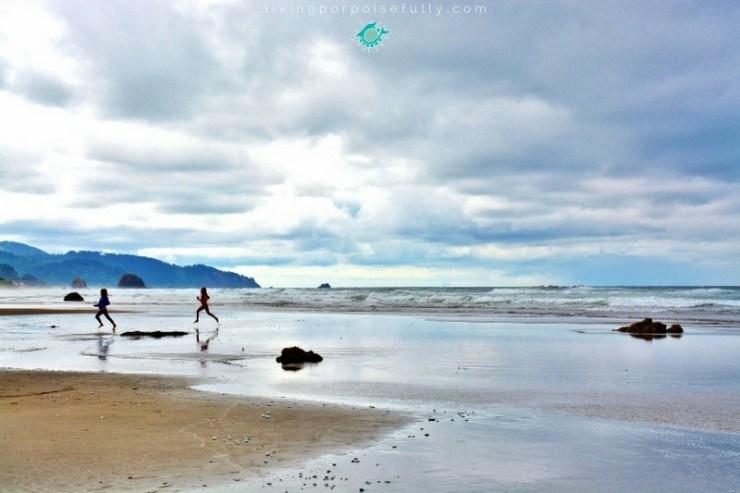 children-running-on-cannon-beach