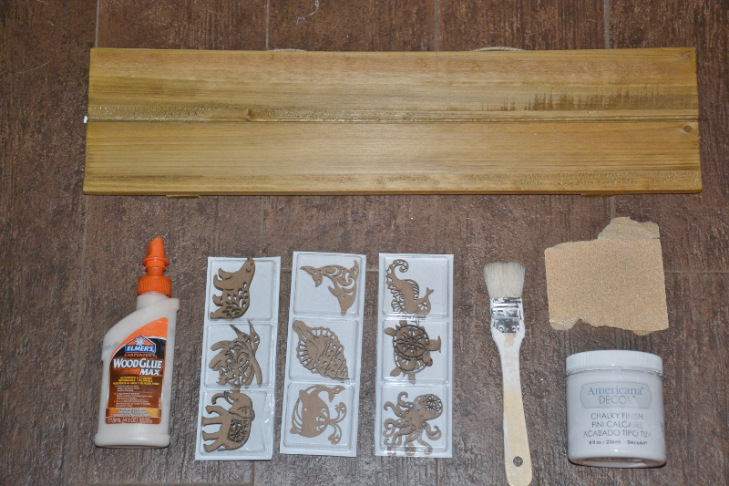 supplies for sea animals wall art - wood board, wood animals, chalky paint, paintbrush, glue