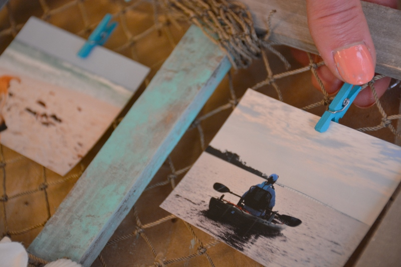 add clothespins to fishing net frame