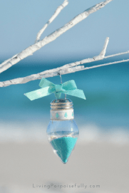 turquoise aqua sand and shells in clear light bulb ornament
