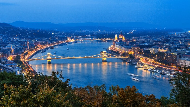 48 hours in Budapest: Image of The Szechenyi Chain Bridge lit up at night.