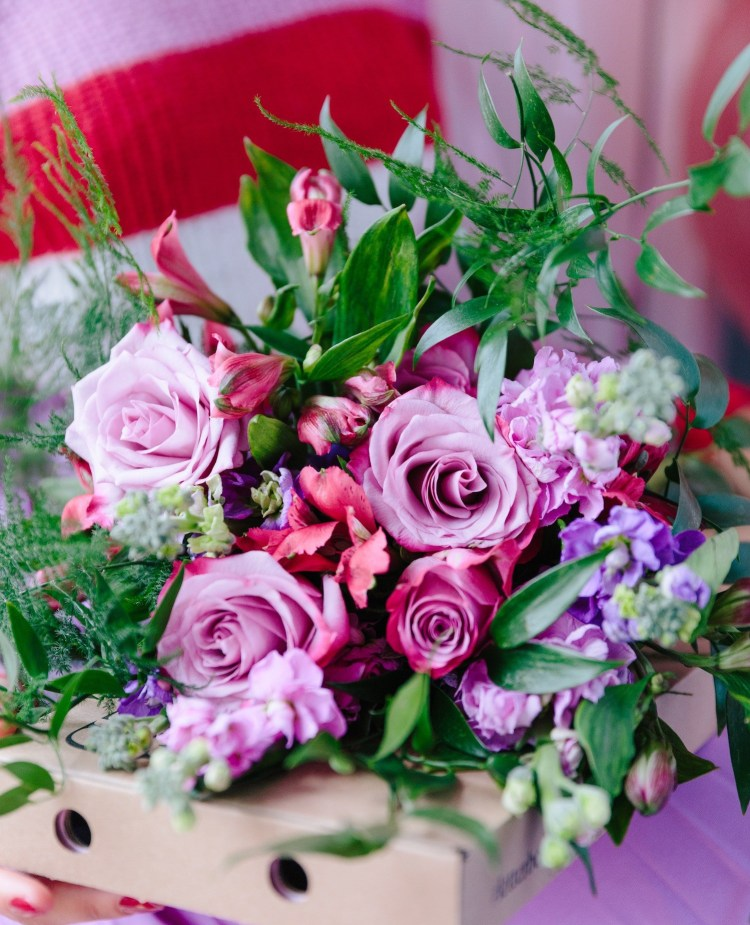 Blooming lovely: the positive power of flowers. Image of purple, pink and green flower bouquet