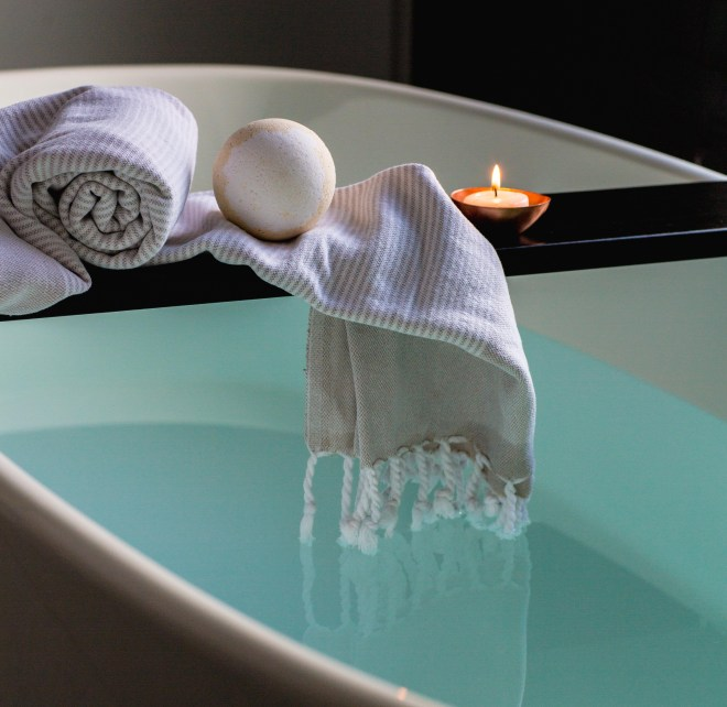 Sleep well: How to win at sleeping! (and why you should want to)  How to get a good night's sleep.  Image of a relaxing bath with a towel and lit candle