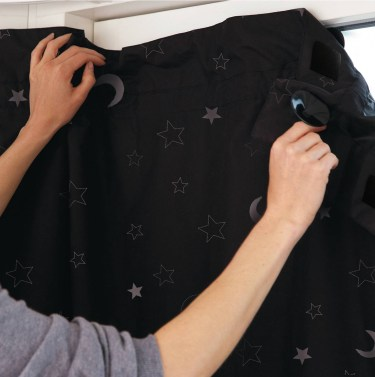 Sleep well: How to win at sleeping! (and why you should want to). How to get a good night's sleep. Image of gro anywhere blind being applied to a window