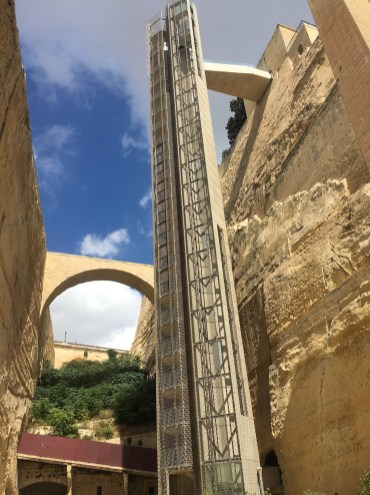 Happy Travels: Where you absolutely should go in Malta. Image of Barrakka Lift