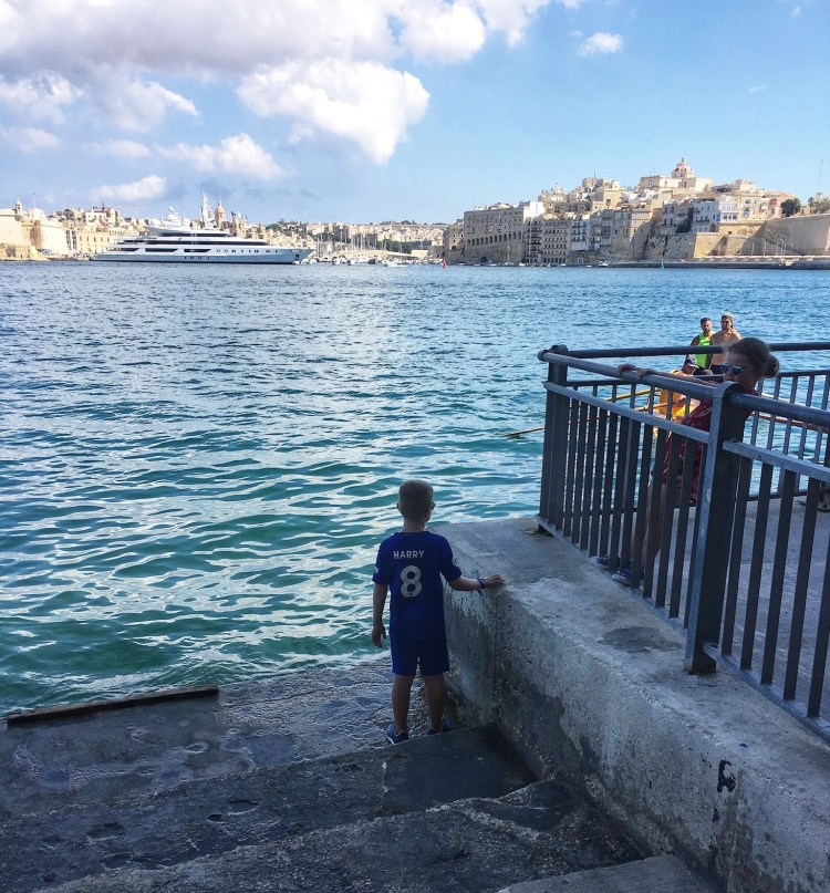 Happy Travels: Where you absolutely should go in Malta. Image of Valletta harbour facing Birgu
