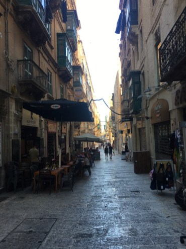 Happy Travels: Where you absolutely should go in Malta. Image of a side street in Valletta