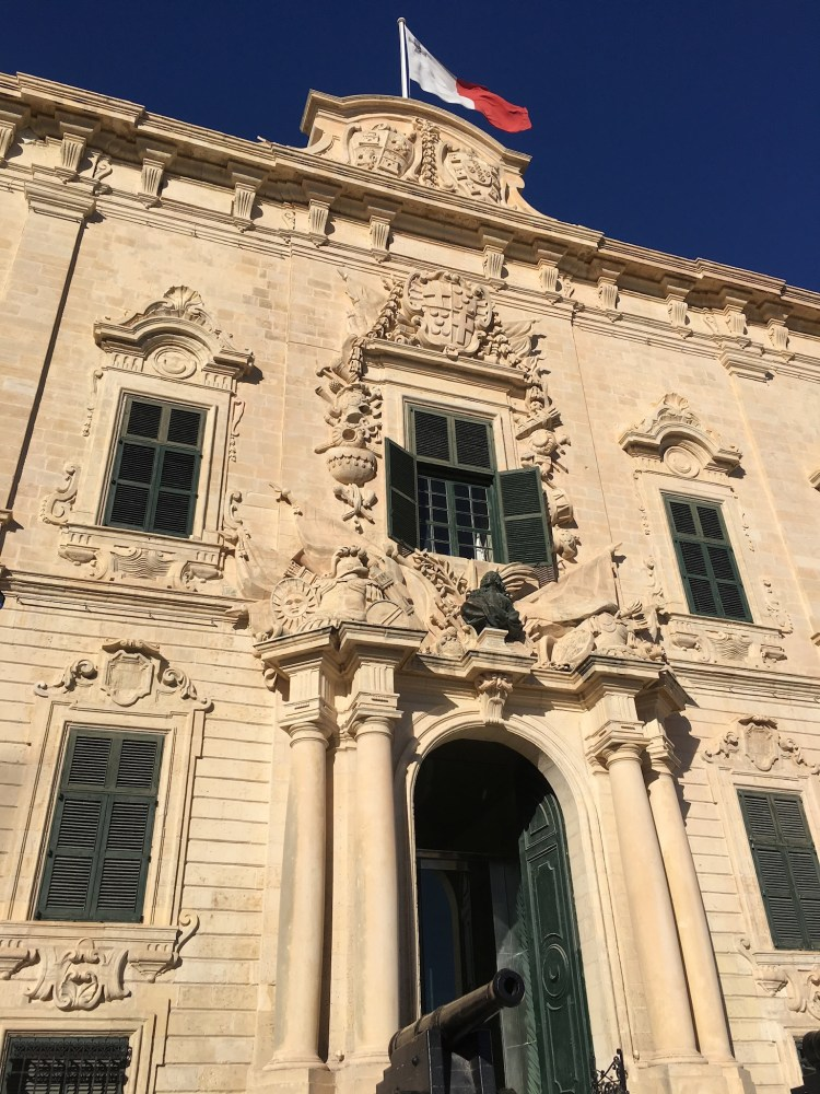 Happy Travels: Where you absolutely should go in Malta. Image of a building in Valletta.