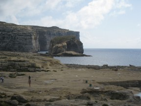 Happy Travels: Where you absolutely should go in Malta. Image of rocks and sea at Azure Window