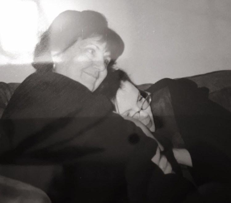Understanding yourself.  Black and white image of Alex Grace cuddling on the sofa with her mum.